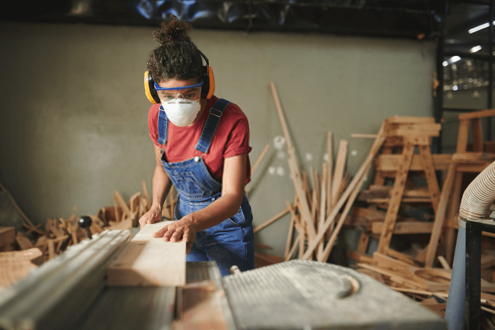 Female working on table saw