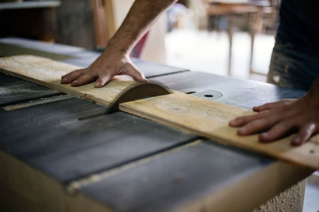 Woodworker cutting wood With Table Saw