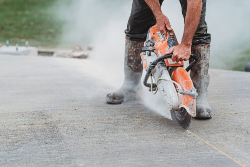 Construction worker Cutting concrete using the best concrete saw