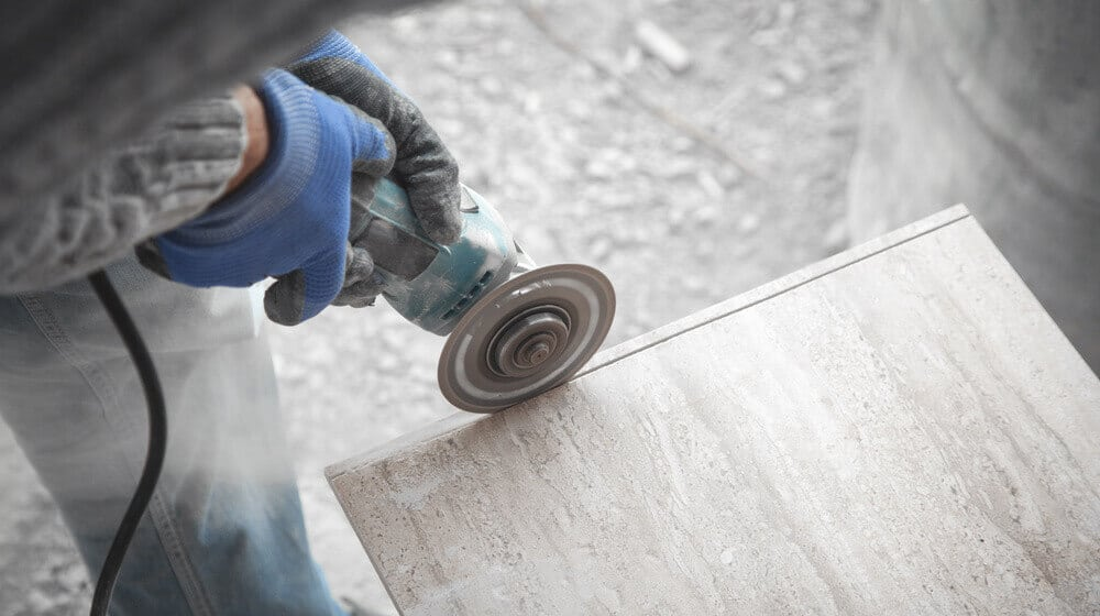 Worker cutting a tile