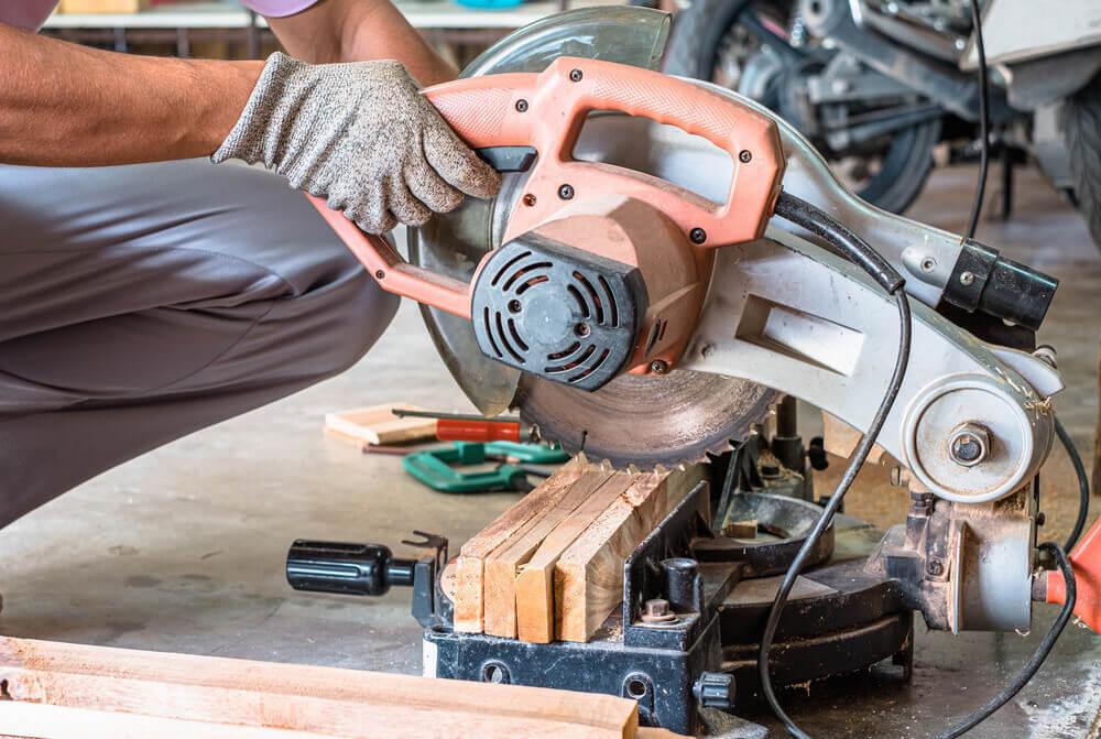 A Miter saw cutting wood