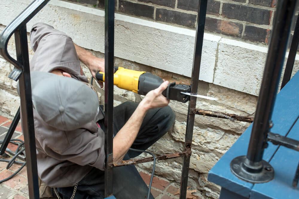 Man Uses Reciprocating Saw To Cut metal pipe