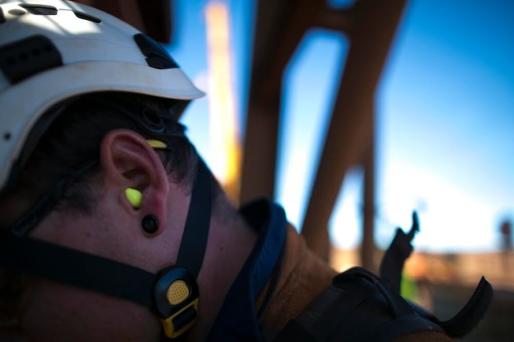 worker wearing a ear plug noise safety protection